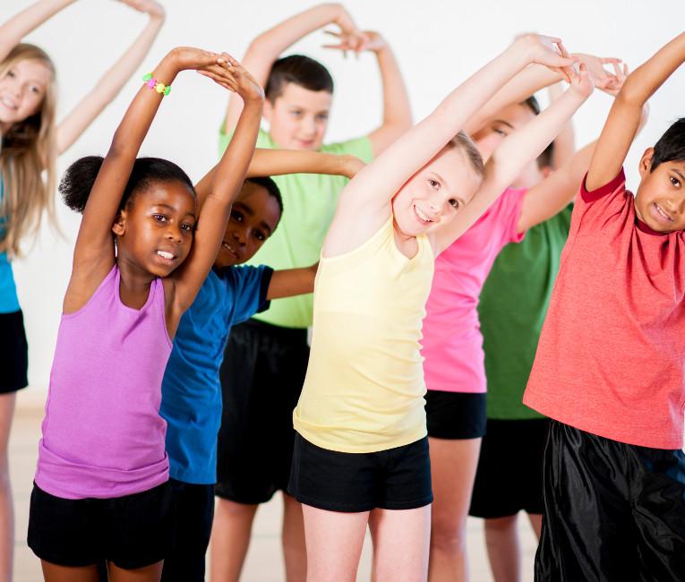 Children Enjoying A Yoga Class